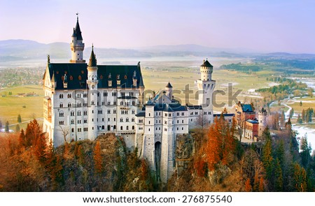 Beautiful Neuschwanstein castle, near Munich in Bavaria, Germany, with colorful trees. - stock photo