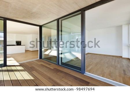 beautiful new  apartment, view of the rooms from the veranda - stock photo