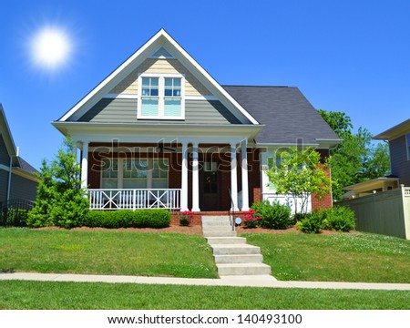 Beautiful, New England Style Suburban American Home with Large Front Porch in the Summertime - stock photo