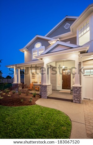 Beautiful New Home Exterior at Night - stock photo