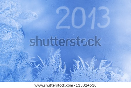 Beautiful New Year background (frozen window with 2013 written on it) - stock photo
