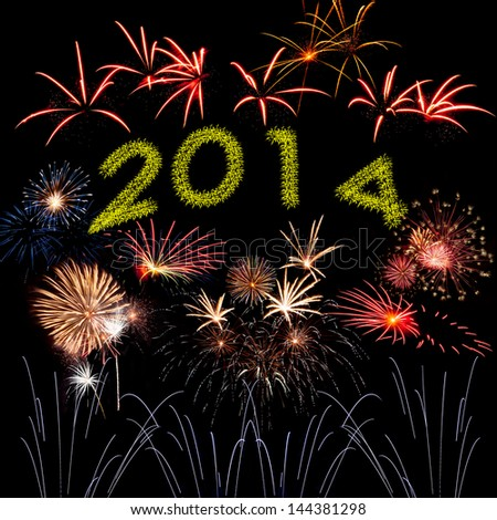 Beautiful New Year holiday fireworks on the black sky background - stock photo