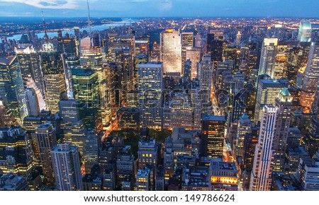 Beautiful New York City skyline with urban skyscrapers at sunset. - stock photo