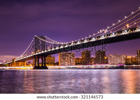 Beautiful  New York City view of the The Manhattan Bridge looking towards Manhattan from Brooklyn at night