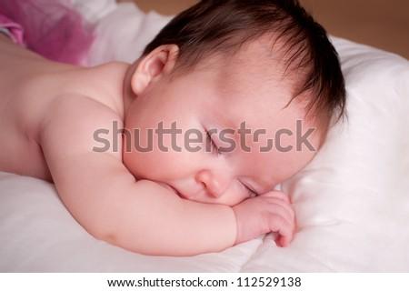 Beautiful newborn baby girl sleeping - stock photo