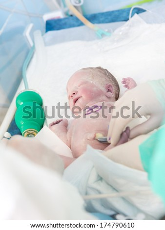 Beautiful newborn baby in hospital - stock photo