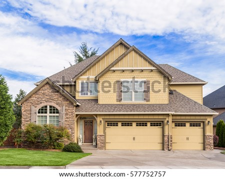 beautiful newly built luxury home exterior with three car garage - Luxury House Exterior