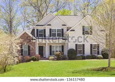 Beautiful Newly Constructed Modern Home Among the Trees. - stock photo