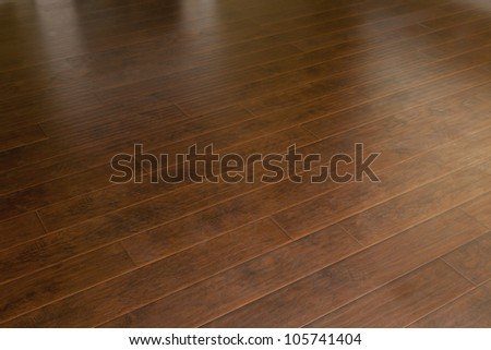 Beautiful Newly Installed Brown Laminate Flooring in Home. - stock photo