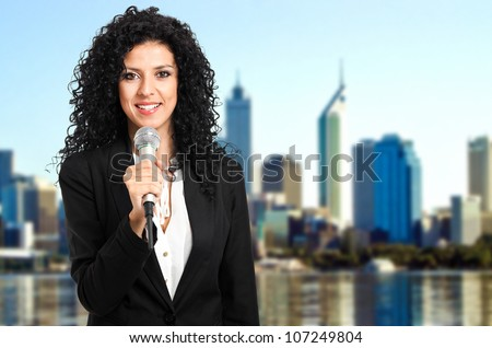 Beautiful newsreader - stock photo