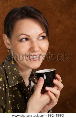Beautiful nice Caucasian woman is on a brown background