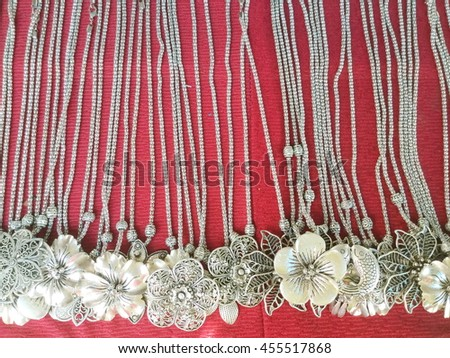 Beautiful nice shiny precious detailed stainless steel handcraft necklaces as contemporary fashion accessories for sale in a jewelry shop in Thailand - stock photo