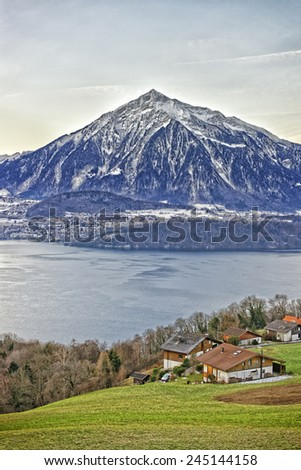 Beautiful Niesen Mountain and lakeview near Thun lake in Swiss Alps in winter - stock photo