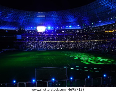 Beautiful night football stadium and light rays