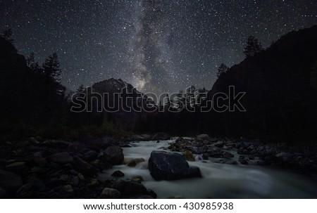 Beautiful night landscape with river and mountain Aktru Karatash. Milky Way with stars in the Altai Mountains. Siberia. Russia - stock photo