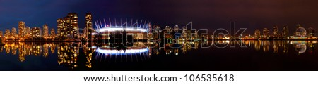 Beautiful night of the Vancouver skyline from False Creek. - stock photo
