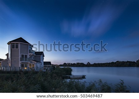 Beautiful night sky astrophotography landscape image of stars over still lake