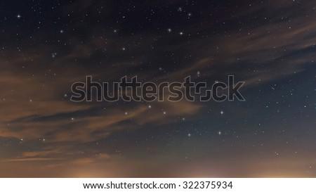 Beautiful night sky, with clouds and constellations, Hercules, Draco, Ursa Major, Ursa Minor, Big Dipper, Botes - stock photo