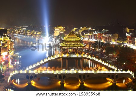 beautiful night view of  bridge/pavilion at Fenghuang (Phoenix) ancient town,Hunan province, China - stock photo