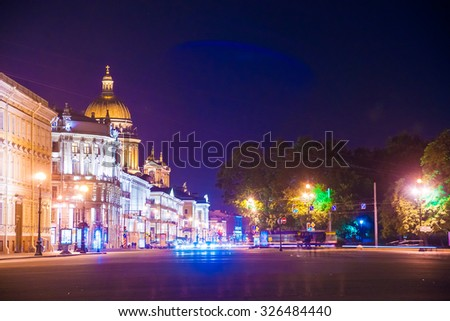 Beautiful night view of Nevsky Prospect and Isaac's Cathedral near Palace Square in Saint Petersburg. Colorful illumination for prominent russian landmark. Saint-Petersburg, Russia