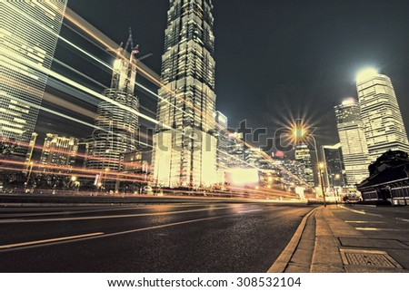 beautiful night view of shanghai finance and trade zone - stock photo