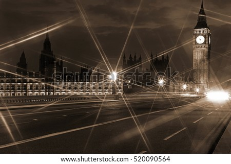 Beautiful night view to Big Ben and Houses of Parliament from Westminster Bridge  through nigh lamp rays, London, UK