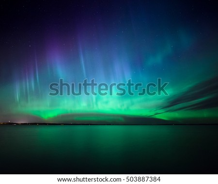 Beautiful northern lights aurora borealis over lake in finland