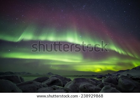 Beautiful Northern Lights over the glacier ice, Arctic