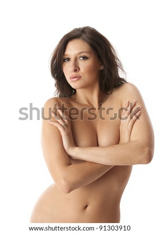 Beautiful nude brunette woman crossing her arms over her breasts - stock photo