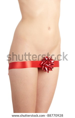 Beautiful nude female as a gift decorated with red ribbon (christmas, birthday or valentines) - stock photo
