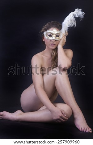beautiful nude in studio with mask - stock photo