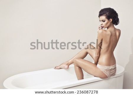 Beautiful nude sexy woman in the bath  - stock photo