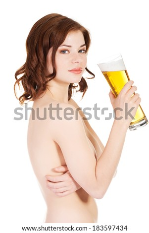 Beautiful nude woman is holding glass with beer. - stock photo