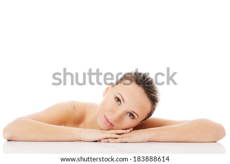 Beautiful nude woman is lying on her hands. Isolated on white. - stock photo