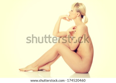 Beautiful nude woman. Isolated on white background.