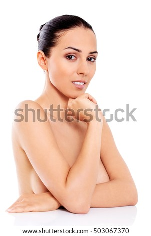 Beautiful nude woman isolated on white background.