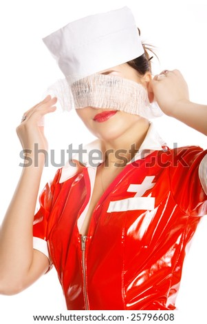 Beautiful nurse  looks through bandage - stock photo