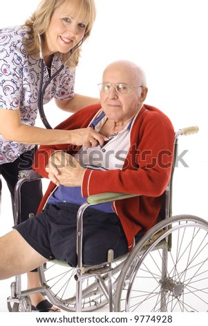 beautiful nurse taking care of elderly patient - stock photo