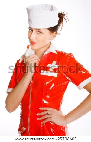 Beautiful nurse with bandaging finger - stock photo