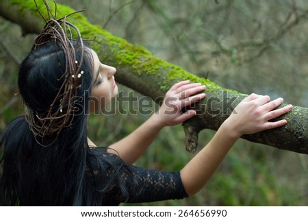 Beautiful nymph bringing sprint to the forest - stock photo