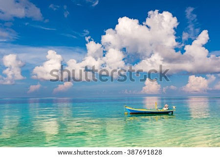 Beautiful ocean beach and boat on Maldives - stock photo