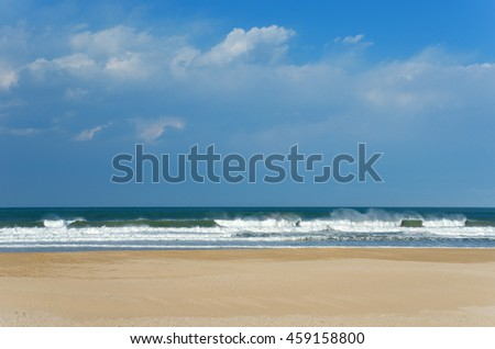 Beautiful ocean beach with waves and sand in South Africa  - stock photo