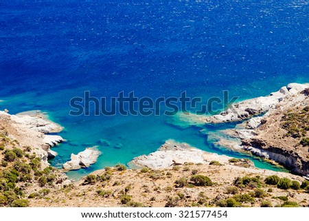Beautiful ocean coastline and rocky beach with turqouise water, Milos island, Greece - stock photo