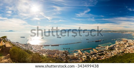 Beautiful ocean panorama view on the rock of Gibraltar and the city around it and African coast on the other side of the channel  - stock photo