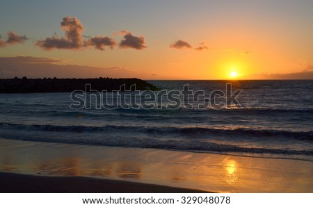 Beautiful ocean sunset with reflection on the water in Tenerife,Canary Islands.
