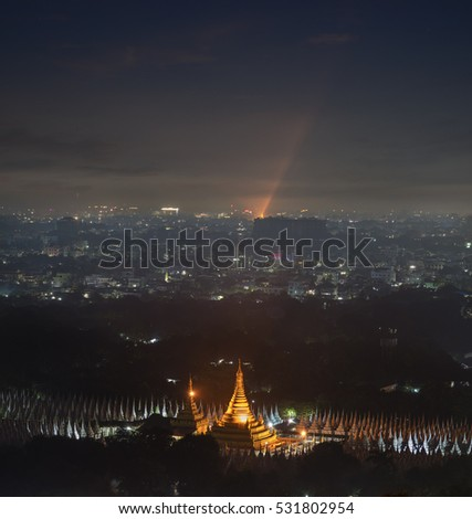 Beautiful of natural and the mist environment during night time at pagoda Mandalay hill in Myanmar