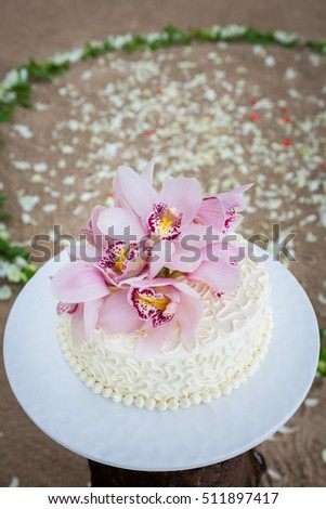Beautiful of  Wedding Cake with Flowers on Top.