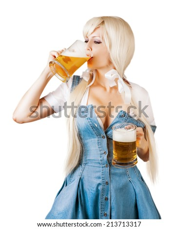 Beautiful oktoberfest young sexy woman wearing a dirndl with two froth beer mugs drink beer from mug isolated on white background