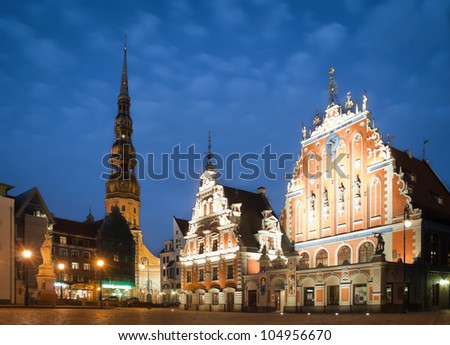 Beautiful old architecture of the central square of Riga. Night view with blue cloudy sky in background and illuminated buildings in foreground. Riga, Latvia, Baltic, Europe. - stock photo