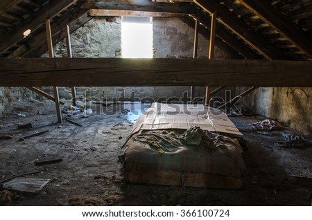 Beautiful old attic with old bed and torn things